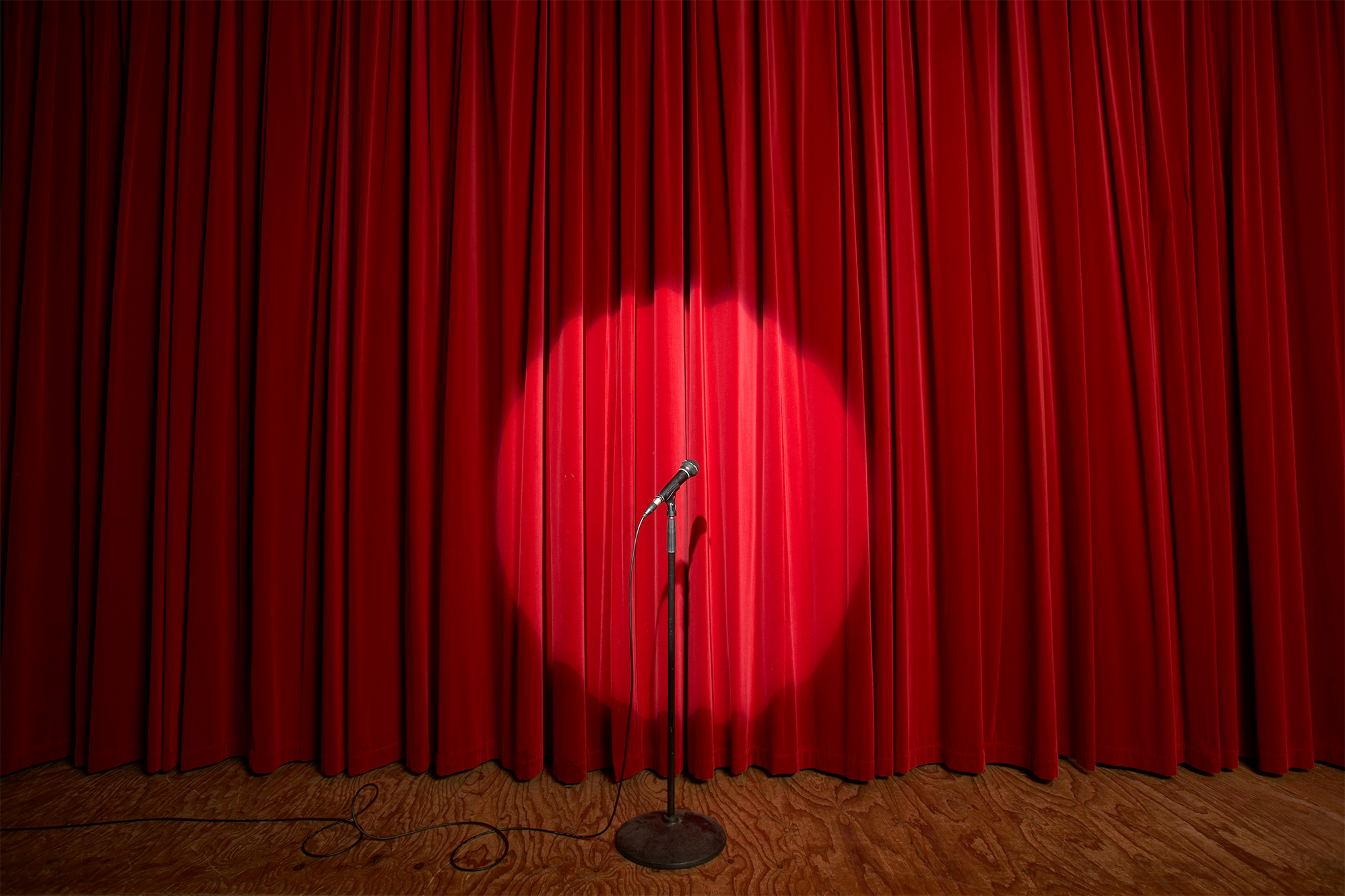 Stage with red curtain and microphone